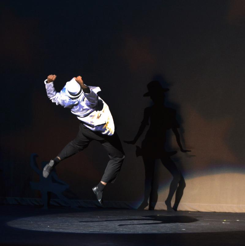 Manny Lloyd performs a solo in a Dance Element Performance in Wilmington NC
